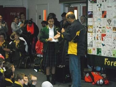 Rotary Representative handing over cheque